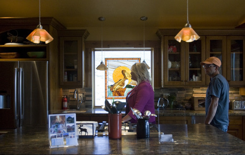 Kim Raff    The Salt Lake Tribune Jennifer Hall and Jeff Sobell walk through the kitchen of the 4,500-square-foot home on Dakota Trail in the Promontory during the Park City Showcase of Homes on September 2, 2012.