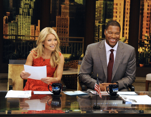 This undated photo shows former football player Michael Strahan, right, and host Kelly Ripa during Strahan's guest-host appearance on