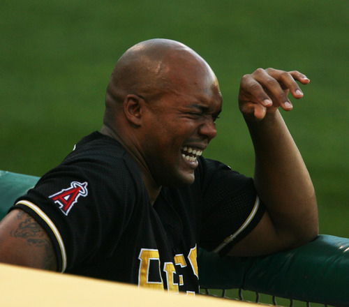 Steve Griffin | The Salt Lake Tribune   Salt Lake's Cory Aldridge laughs with his teammates in the dugout during a game against Tucson at Spring Mobile Ballpark on Wednesday, Aug. 29, 2012.