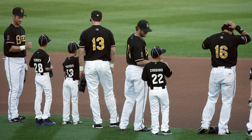 Steve Griffin | The Salt Lake Tribune   Little leaguers take the field, with the Bees, for the