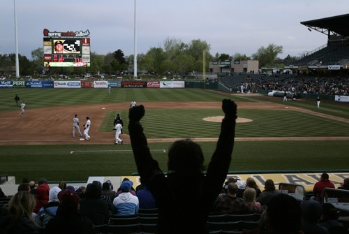 Kim Raff | The Salt Lake Tribune Bees fans cheer as Mike Trout hits a triple during the Bees home opener against Tucson Padres at Spring Mobile Ballpark in Salt Lake City on April 13, 2012.