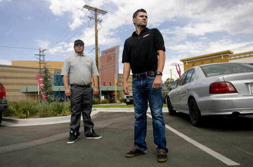 Kim Raff |  The Salt Lake Tribune Legacy Towing owner (right) Schafer Magana and Dustin Shurtleff, the tow truck driver who towed Aaron Zundel's car, stand in the parking lot of 33rd St. Station.