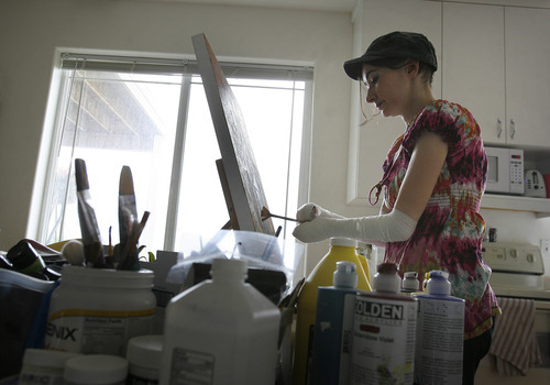 Scott Sommerdorf  |  The Salt Lake Tribune              Jamie Hartley, 34, paints at her home in Alpine to distract herself from the pain of her rare and deadly skin disorder. Hartley is a Utah delegate to the Democratic National Convention. Because of her disorder, health care is her top issue.