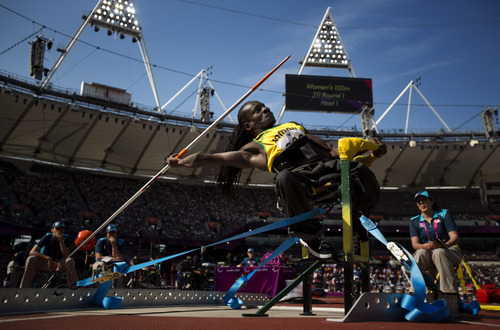 Jamaica's Alphanso Cunninghan competes in the men's Javelin Throw F52/53 at the 2012 Paralympics in London, Tuesday, Sep. 4, 2012. (AP Photo/Emilio Morenatti)