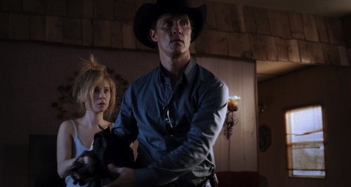 Cop-turned-contract killer Joe Cooper (Matthew McConaughey, right) meets with Dottie (Juno Temple), the slow-witted daughter of the woman Joe has been hired to kill, in the drama