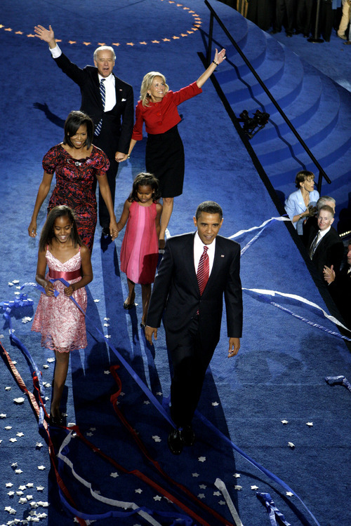Democratic presidential nominee, Sen. Barack Obama, D-Ill., his wife, Michelle, and daughters Malia, and Sasha, are joined on stage by his running mate, Sen. Joe Biden, D-Del., and his wife, Jill, after Obama's acceptance speech at the Democratic National Convention in Denver, Thursday, Aug. 28, 2008.  (AP Photo/Chris Carlson)