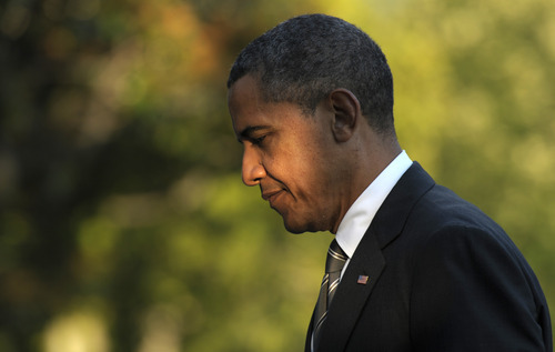 President Barack Obama walks from Marine One on the South Lawn of the White House in Washington, Wednesday, Aug. 29, 2012, after returning from campaigning. (AP Photo/Susan Walsh)