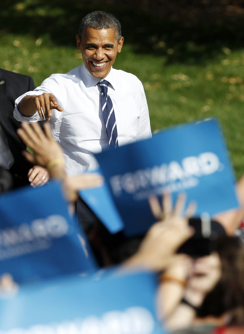 President Obama gestures to supporters as he takes the stage during campaign stop on the campus of Colorado State University in Fort Collins, Colo., on Tuesday, Aug. 28, 2012.  (AP Photo/David Zalubowski)