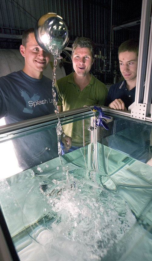 Paul Fraughton | The Salt Lake Tribune Tadd Truscott, a professor of mechanical engineering at BYU,  center, with engineering grad students Randy Munns and Kyle Bodily watch as a buoyant sphere breaks the surface of a water tank and launches itself into the air. Using high-speed photography and other recording devices,  the engineers at the university's splash lab are studying the interplay between moving objects and liquids.