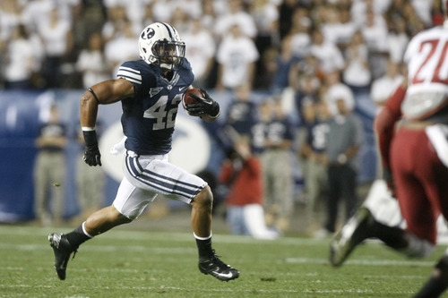 Chris Detrick  |  The Salt Lake Tribune Brigham Young Cougars running back Michael Alisa (42) runs the ball during the first half of the game against Washington State at LaVell Edwards Stadium Thursday August 30, 2012. BYU is winning the game 24-6.