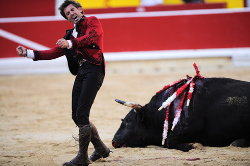 File - In this July 6, 2012 file photo, Spanish mounted bullfighter Pablo Hermoso de Mendoza celebrates beside a dead bull after a horseback bullfight in Pamplona, northern Spain. Spain's state TV will start airing live bullfights again on Sept. 5, 2012 after the new conservative government lifted a six-year ban on the tradition that has been hard hit by declining popularity and the economic crisis. It's a big victory for pro-bullfighting forces who saw fights prohibited this year in the northeastern region of Catalonia. And it's a defeat for animal rights activists who denounce bullfighting as barbaric. The live transmissions were halted in 2006 by Spain's previous Socialist administration, which said they were costly and coincided with youth TV viewing hours. (AP Photo/Alvaro Barrientos, File)