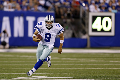 Dallas Cowboys quarterback Tony Romo runs with the ball against the New York Giants during the first half of an NFL football game Wednesday, Sept. 5, 2012, in East Rutherford, N.J. (AP Photo/Julio Cortez)