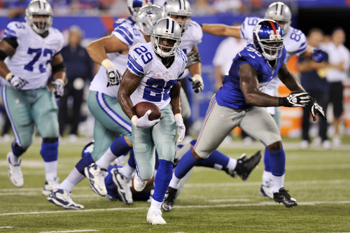 Dallas Cowboys running back DeMarco Murray (29) runs with the ball during the second half of an NFL football game against the New York Giants Wednesday, Sept. 5, 2012, in East Rutherford, N.J. (AP Photo/Bill Kostroun)