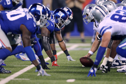 The New York Giants face off against the Dallas Cowboys during the first half of an NFL football game Wednesday, Sept. 5, 2012, in East Rutherford, N.J. (AP Photo/Seth Wenig)