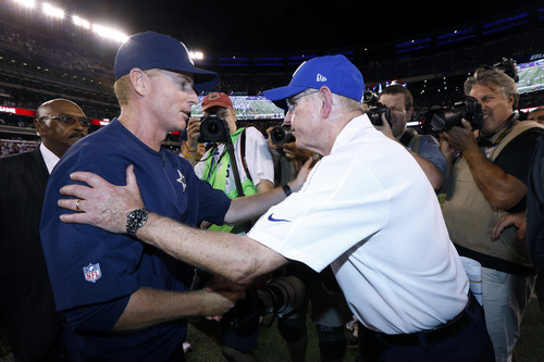 Dallas Cowboys head coach Jason Garrett, left, and New York Giants head coach Tom Coughlin shake hands at the end of an NFL football game Wednesday, Sept. 5, 2012, in East Rutherford, N.J. The Cowboys won the game 24-17. (AP Photo/Julio Cortez)