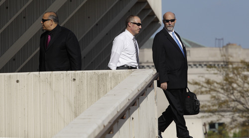 From left, Joe Lopez, Steven Greenburg, and Joel Brodsky, attorneys for former Bolingbrook police officer Drew Peterson, leave the Will County Courthouse in Joliet, Ill., Tuesday, Sept. 4, 2012, after closing arguments in Peterson's murder trial. Peterson is charged in the 2004 death of his third wife Kathleen Savio. Jurors are expected to begin deliberating tomorrow. (AP Photo/M. Spencer Green)
