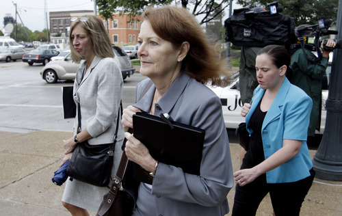 Will County Assistant State's Attorney Kathleen Patton, center enters court for jury instructions in the murder trial of former Bolingbrook police officer Drew Peterson, Wednesday, Sept. 5, 2012, in Joliet, Ill. Jurors are expected to begin deliberating on allegations the former suburban Chicago police officer murdered his third wife. (AP Photo/M. Spencer Green)