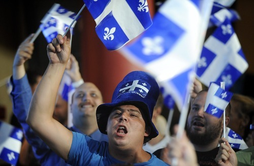 Parti Quebecois supporters cheer as election results are announced in Montreal, Tuesday, Sept. 4, 2012. The separatist party won power in the French-speaking province of Quebec on Tuesday night, but another referendum to break away from Canada isn't expected any time soon after the Parti Quebecois failed to win a majority of legislative seats. (AP Photo/The Canadian Press, Graham Hughes)