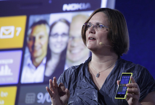 Jo Harlow, vice president of Nokia, introduces its newest smartphone, the Lumia 920, equipped with Microsoft's Windows Phone 8, Wednesday, Sept. 5, 2012 in New York. Nokia revealed its first smartphones to run the next version of Windows, a big step for a company that has bet its future on an alliance with Microsoft.  (AP Photo/Mark Lennihan)