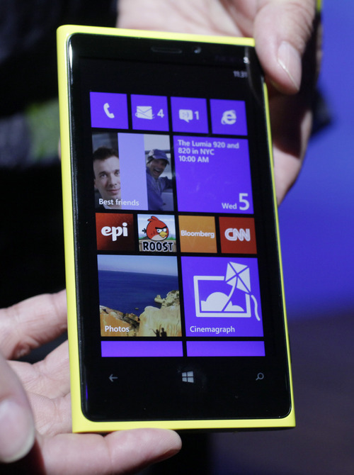 The Nokia Lumia 920, equipped with Microsoft's Windows Phone 8, is displayed, Wednesday, Sept. 5, 2012 in New York. Nokia revealed its first smartphones to run the next version of Windows, a big step for a company that has bet its future on an alliance with Microsoft.  (AP Photo/Mark Lennihan)