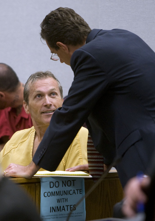 Martin Joseph MacNeill, left, talks with his attorney Randall Spencer prior to making his initial appearance Monday, Aug. 27, 2012 before Judge Samuel D. McVey in Provo on a murder charge in the death of his wife, Michele MacNeill.