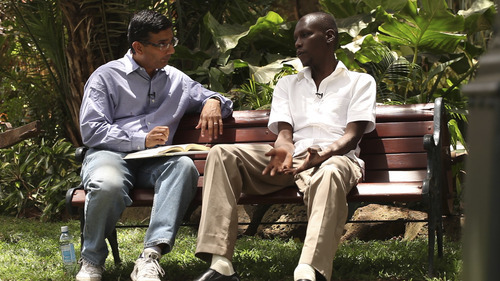 Dinesh D'Souza and George Obama converse in
