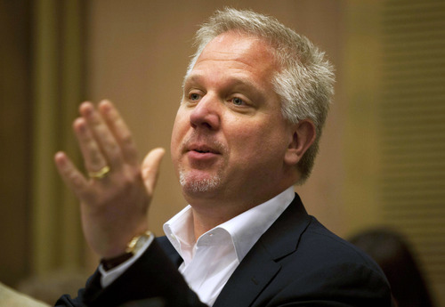 FILE - In this July 11, 2011 file photo, radio talk show host Glenn Beck speaks in the Knesset, Israel's parliament, in Jerusalem. For a second straight day, Beck on Wednesday, Sept. 5, 2012 used his show to complain that an American Airlines flight attendant treated him rudely. Beck claims it was punishment for his conservative views. (AP Photo/Sebastian Scheiner, File)