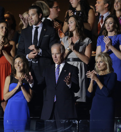 Vice President Joe Biden, center, is applauded during the Democratic National Convention in Charlotte, N.C., on Thursday, Sept. 6, 2012. (AP Photo/Lynne Sladky)