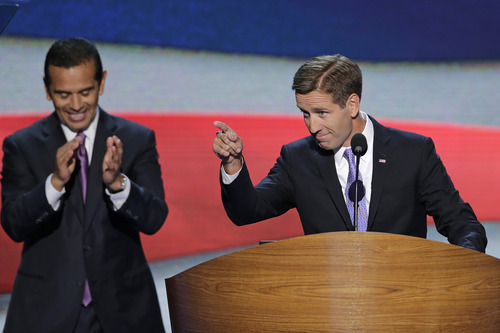 Beau Biden, Attorney General of Delaware and son of Vice President Joe Biden points towards the delegates before his nominates his father during the Democratic National Convention in Charlotte, N.C., on Thursday, Sept. 6, 2012. Los Angeles Mayor and Democratic Convention Chairman Antonio Villaraigosa claps in the background. (AP Photo/J. Scott Applewhite)