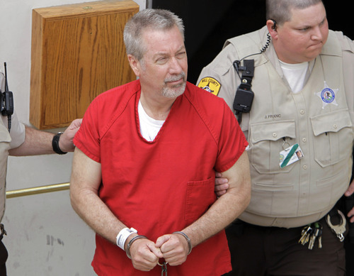 FILE - In this May 8, 2009 file photo, former Bolingbrook, Ill., police sergeant Drew Peterson leaves the Will County Courthouse in Joliet, Ill., after his arraignment on charges of first-degree murder in the 2004 death of his former wife Kathleen Savio. On Wednesday, Sept. 6, 2012, jurors at Peterson's trial withdrew to begin deliberations on whether Peterson murdered his third wife. (AP Photo/M. Spencer Green, File)
