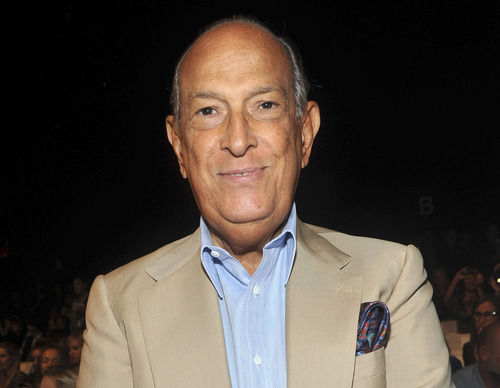 FILE - In this Sept. 11, 2011 file photo, designer Oscar de la Renta attends the Diane von Furstenberg Spring 2012 fashion show during Fashion Week in New York. De la Renta received the 2012 Couture Council Award Wednesday, Sept. 5, by The Fashion Institute of Technology in New York. (AP Photo/Diane Bondareff, file)
