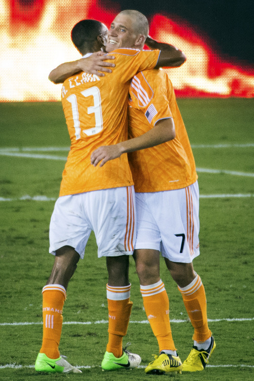 Houston Dynamo midfielder Colin Clark (7) celebrates with defender Ricardo Clark after Clark scored a penalty kick to give them a 1-0 victory over Real Salt Lake in an MLS soccer match, Thursday, Sept. 6, 2012, in Houston. (AP Photo/Houston Chronicle, Smiley N. Pool)  MANDATORY CREDIT