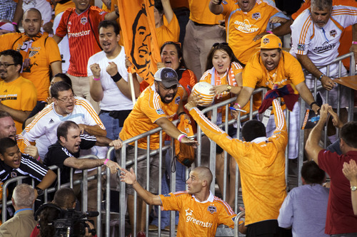 Houston Dynamo midfielder Colin Clark celebrates with fans after scoring on a penalty kick during stoppage time for a 1-0 victory over Real Salt Lake in an MLS soccer match, Thursday, Sept. 6, 2012, in Houston. (AP Photo/Houston Chronicle, Smiley N. Pool)  MANDATORY CREDIT