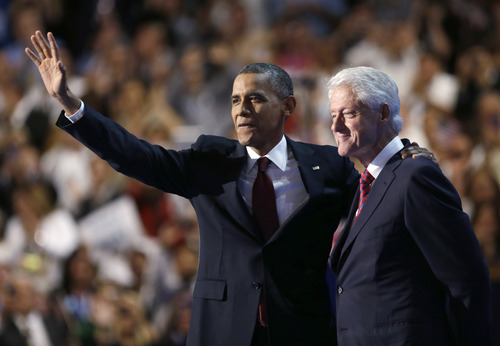 President Barack Obama waves after Former President Bill Clinton addresses the Democratic National Convention in Charlotte, N.C., on Wednesday, Sept. 5, 2012. (AP Photo/David Goldman)