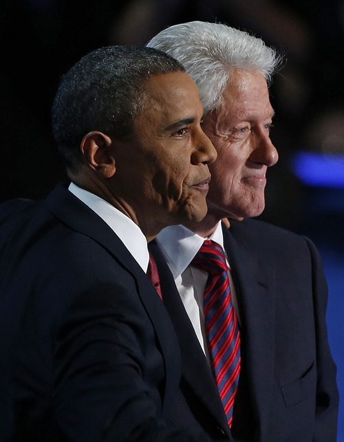 President Barack Obama stands with Former President Bill Clinton after Clintons' address to the Democratic National Convention in Charlotte, N.C., on Wednesday, Sept. 5, 2012. (AP Photo/Carolyn Kaster)