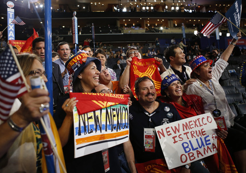 New Mexico delegates cheer as President Barack Obama is nominated for the Office of the President of the United States at the Democratic National Convention in Charlotte, N.C., on Thursday, Sept. 6, 2012. (AP Photo/Jae C. Hong)