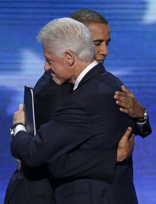 Former President Bill Clinton hugs President Barack Obama after President Obama walked on stage after Clinton's speech the Democratic National Convention in Charlotte, N.C., on Wednesday, Sept. 5, 2012. (AP Photo/J. Scott Applewhite)