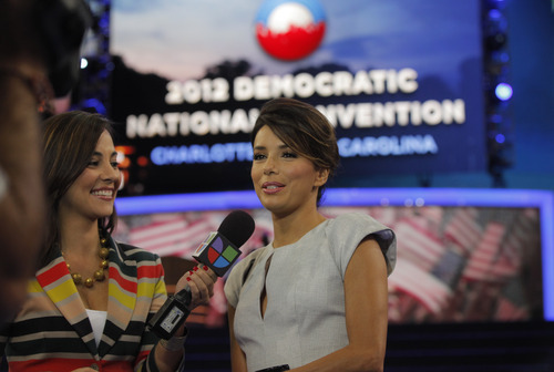 Actress Eva Longoria, right, is interviewed by Mariana Atencio of Univision on the floor of the Democratic National Convention in Charlotte, N.C., Thursday, Sept. 6, 2012. (AP Photo/Charles Dharapak)