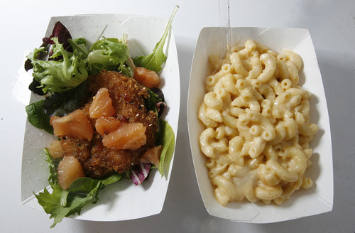 Scott Sommerdorf  |  The Salt Lake Tribune              Gourmet Alaskan King Crab cakes, left, and mac and cheese from Utah chef Carl Rubadue's new food truck