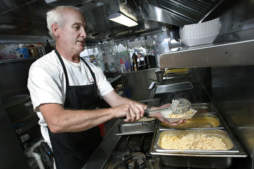 Scott Sommerdorf  |  The Salt Lake Tribune              Long-time Utah chef Carl Rubadue dishes up an order of mac and cheese in his new food truck,