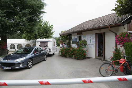 A car drives at the entrance of the campground where the slain British family were holidaying in Saint Jorioz, near Annecy, Thursday, Sept. 6, 2012.  A 4-year-old British girl hid for eight hours beneath the bodies of slain family members in the back of their car in a nearby forest, before she was discovered by French investigators who had been guarding the vehicle, a prosecutor said Thursday.  Three people, a man and two women, had been shot to death, as was a French cyclist whose body was found nearby.  (AP Photo/Alexis Moro)