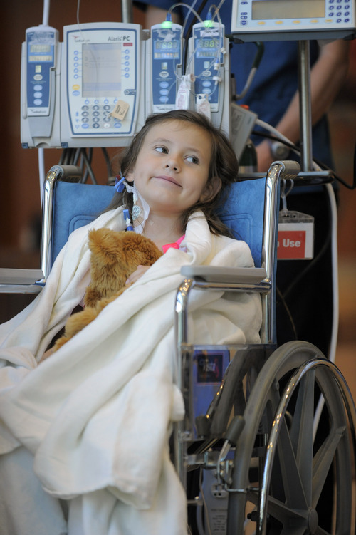 Seven-year-old Sierra Jane Downing from Pagosa Springs, Colo., smiles during a news conference about her recovery from bubonic plague at the Rocky Mountain Hospital for Children at Presbyterian/St. Luke's Wednesday, Sept. 5, 2012, in Denver. It is believed Downing caught the bubonic plague from burying a dead squirrel. (AP Photo/Jack Dempsey)