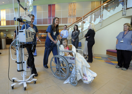 Seven-year-old Sierra Jane Downing from Pagosa Springs, Colo., is pushed in a wheel chair by a nurse following a news conference about her recovery from Bubonic Plague at the Rocky Mountain Hospital for Children at Presbyterian/St. Luke's Wednesday, Sept. 5, 2012, in Denver. It is believed Downing caught the Bubonic Plague from burying a dead squirrel. (AP Photo/Jack Dempsey)
