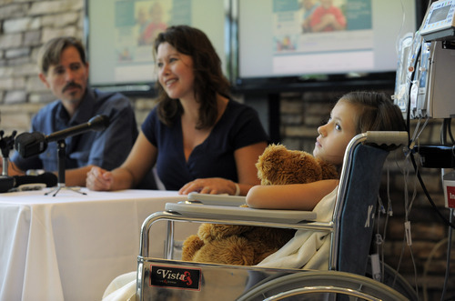 Seven-year-old Sierra Jane Downing from Pagosa Springs, Colo., looks on while her father Sean Downing and mother Darcy Downing talk about her recovery from Bubonic Plague at the Rocky Mountain Hospital for Children at Presbyterian/St. Luke's during a news conference Wednesday, Sept. 5, 2012, in Denver. It is believed Downing caught the Bubonic Plague from burying a dead squirrel. (AP Photo/Jack Dempsey)