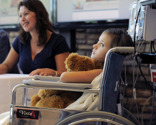 Seven-year-old Sierra Jane Downing, from Pagosa Springs, Colo., watches while her father Sean Downing and mother Darcy Downing talk about her recovery from Bubonic Plague at the Rocky Mountain Hospital for Children at Presbyterian/St. Luke's during a news conference Wednesday, Sept. 5, 2012, in Denver. It is believed Downing caught the Bubonic Plague from burying a dead squirrel. (AP Photo/Jack Dempsey)