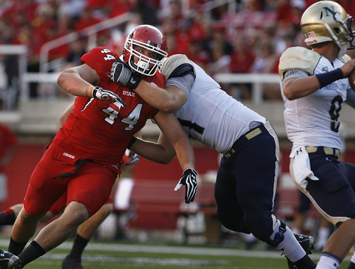Scott Sommerdorf  |  The Salt Lake Tribune              Utah DT Dave Kruger is held back as he rushes the QB during first quarter play. Utah held a 7-0 lead over Northern Colorado early in the second quarter on Jordan Wynn's 10 yard TD pass to Jake Murphy, Thursday, August 30, 2012.