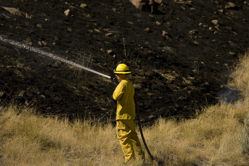 Kim Raff | The Salt Lake Tribune Firefighters work to contain a brush fire in Wanship on Wednesday, Sept. 5, 2012. The fast-moving brush fire forced some residents to evacuate.