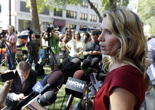 Pam Bosco, a family spokesperson for Stacy Peterson, speaks outside the Will County Courthouse in Joliet, Ill., Thursday, Sept. 6, 2012, after a jury convicted former Bolingbrook, Ill., police officer Drew Peterson of murdering his third wife, Kathleen Savio, in 2004. Peterson, the former suburban Chicago police officer who generated a media storm after his much-younger fourth wife, Stacy Peterson, vanished in 2007, was convicted in a case based mainly on secondhand hearsay statements from the two women. (AP Photo/M. Spencer Green)