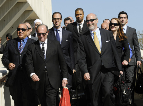 Defense team members for former Bolingbrook, Ill., police officer Drew Peterson, lead by Joel Brodsky, front right, leave the Will County Courthouse in Joliet, Ill., Thursday, Sept. 6, 2012, after a jury convicted Peterson of murdering his third wife, Kathleen Savio, in 2004. Peterson, the swaggering former suburban Chicago police officer who generated a media storm after his much-younger fourth wife, Stacy Peterson, vanished in 2007, was convicted in a case based mainly on secondhand hearsay statements from the two women. He faces a maximum 60-year prison term when sentenced on Nov. 26. Illinois has no death penalty.  (AP Photo/Paul Beaty)