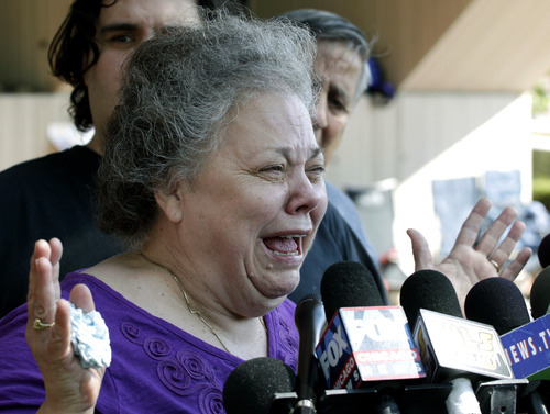 Marcia Savio, stepmother of Kathleen Savio speaks outside the Will County Courthouse in Joliet, Ill., Thursday, Sept. 6, 2012, after a jury convicted former Bolingbrook, Ill., police officer Drew Peterson of murdering his wife, Kathleen, in 2004. He faces a maximum 60-year prison term when sentenced on Nov. 26. Illinois has no death penalty. (AP Photo/M. Spencer Green)
